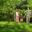 Happy Family walking outdoors — Foto Stock