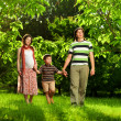 Happy Family walking outdoors — Stock Photo