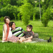 Happy Family walking outdoors — Stock Photo #7676192