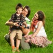 Foto Stock: Happy Family walking outdoors