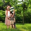Happy Family walking outdoors — Stock Photo #7676232