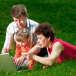 Happy young family enjoy outdoors — Stock Photo #7676249