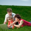 Happy young family enjoy outdoors — Stock Photo #7676281