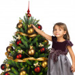 Pretty girl with present near the Christmas tree — Stock Photo #7676358