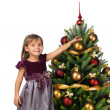 Pretty girl near the Cristmas tree — Stock Photo #7676382