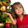 Pretty girl near the Cristmas tree — Foto Stock