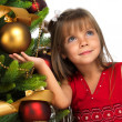 Pretty girl near the Cristmas tree — Foto de Stock