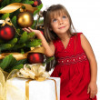 Pretty girl near the Cristmas tree — Stock fotografie