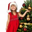 Pretty girl near the Cristmas tree — Stock Photo #7676420