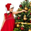 Pretty girl with present near the Cristmas tree — Stock Photo #7676422