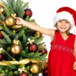 Pretty girl with present near the Cristmas tree — Stock Photo #7676428