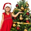 Pretty girl with present near the Christmas tree — Stock Photo #7676441