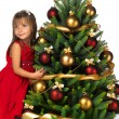 Pretty girl with present near the Christmas tree — ストック写真