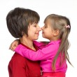 Mother with daughter on white background — Stock Photo