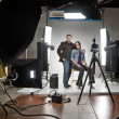 Businessman and woman in a modern photo studio - Stock Photo