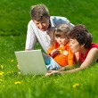 Happy young family enjoy outdoors — Stock Photo