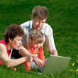 Happy young family enjoy outdoors — Stock Photo #7676747