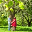 Pregnant woman in park with her husband — Stock Photo
