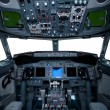 Royalty-Free Stock Photo: Boeing interior, cockpit view inside the airliner, isolated wind