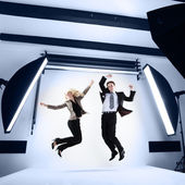 Businessman and woman in a modern photo studio — Stock Photo