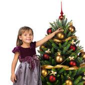 Pretty girl near the Cristmas tree — Stock Photo