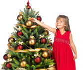 Pretty girl with present near the Cristmas tree — Stock Photo