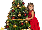 Pretty girl with present near the Christmas tree — Stock Photo