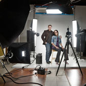Businessman and woman in a modern photo studio — Foto Stock