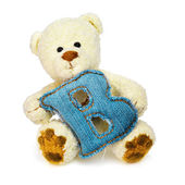 Teddy bear with one letter of jeans alphabet — Stock Photo