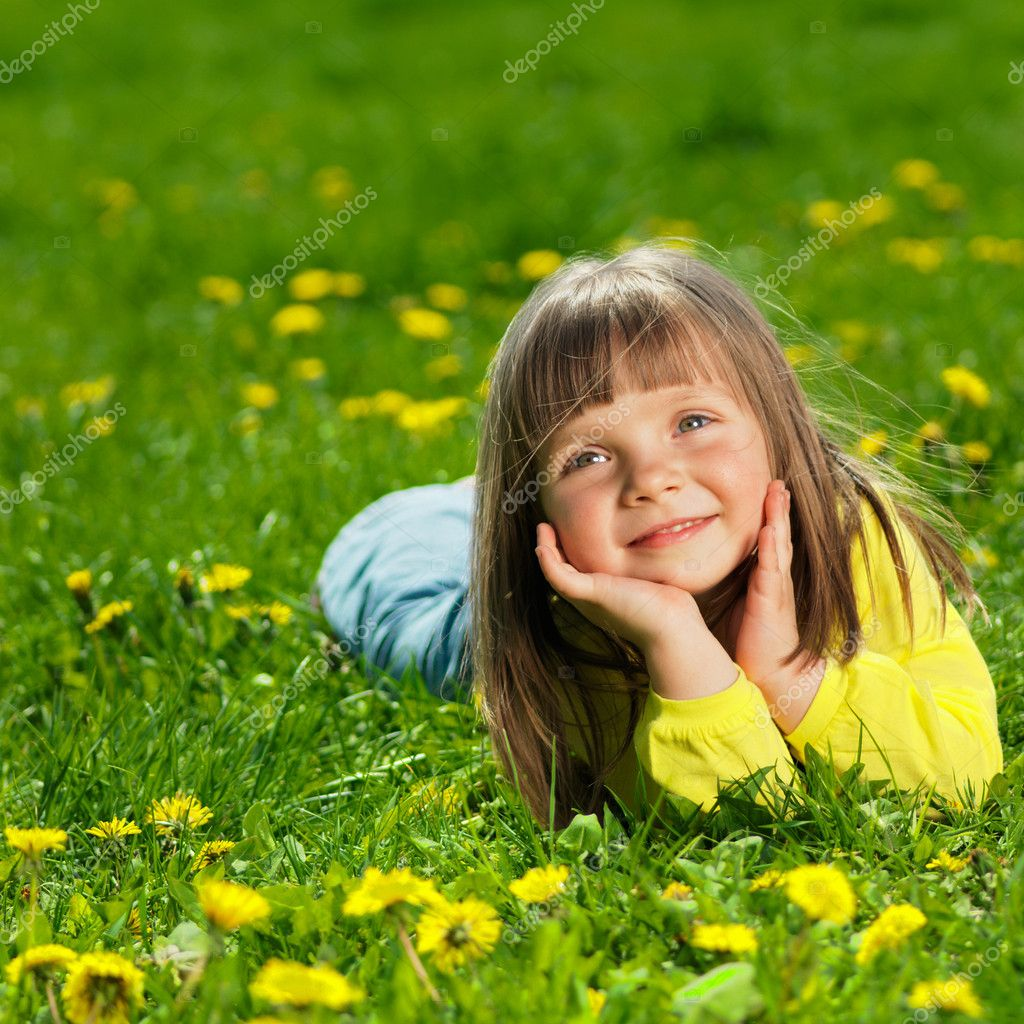 Portrait of a happy little girl in the park  Stock Photo #7676735