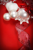 Christmas card with Christmas ribbon and Christmas balls — Stock Photo