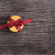 Cookies decorated with dark red polka dots ribbon — Stock Photo