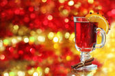 Mulled wine over Christmas decoration — Stock Photo