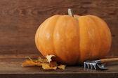 Pumpkin with garden tools — Stock Photo