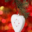 Christmas white heart with against blurred background — Stock Photo #7166855