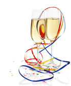 Champagne in two glasses with streamers — Stock Photo