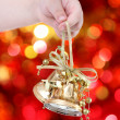 Child holding golden Christmas tree decorations - 图库照片