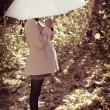 Young pregnant womunder umbrella — Stock Photo #7614351