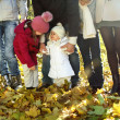 Young happy family in autumn forest — Stock Photo #7651552