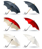 Different umbrellas isolated — Stock Vector