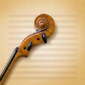 Old violin on a sheet of paper — Stock Photo