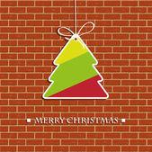 Christmas tree on the brick wall — Stock Photo