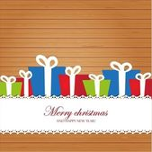 Christmas invitation card on wood background — Stock Photo