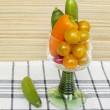 Snack vegetables cherry tomatoes, bell peppers, cucumbers in a stem glass - Stock Photo