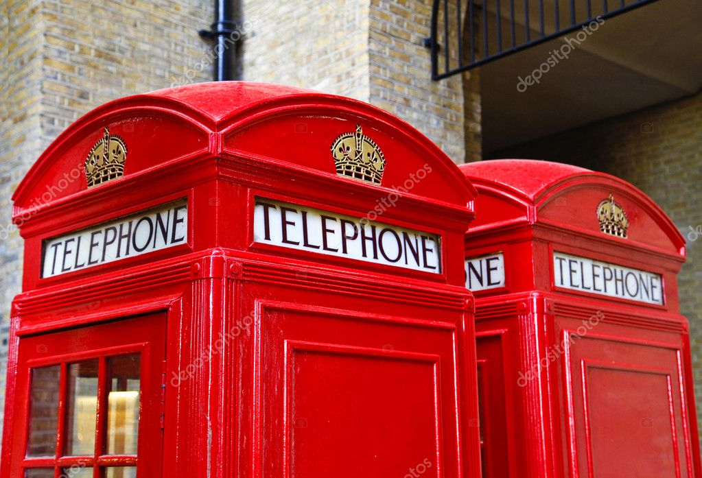 The red telephone box, a public telephone kiosk designed by Sir Giles Gilbert Scott, is a familiar sight on the streets of the United Kingdom — Stock Photo #7712607