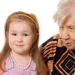 The elderly woman with the granddaughter - Stock Photo