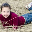 Girl lays on dry grass — Stock Photo #6785594