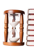 Hourglasses and book isolated on white — Stock Photo