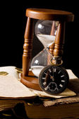The hourglass and the book — Stock Photo