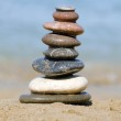 Heap of stones against the sea — Stock Photo